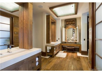 A hand picked hardwood Balinese window, recast and re imagined into the most unique and beautiful vanity that acts as the centerpiece of this well appointed and spacious vanity area.
