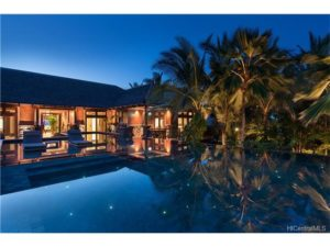 A nightly occurrence: Perfectly still water, perfectly reflected palm trees. All by design. This property is art.