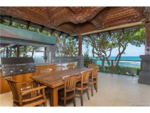 Copper, steel, humed marble and carved lava stone frame the most idyllic oceanfront location.