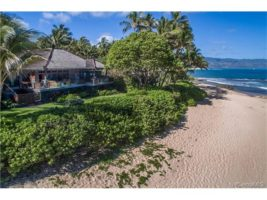 Private and tucked into this pristine sandy beachfront location.