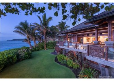 Direct sandy beach oceanfront location but perched just above to allow the best North Shore views with complete privacy. Balinese hardwoods and custom carved Javanese Lava Stone adorn this architectural masterpiece.