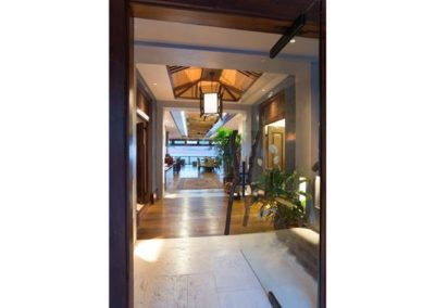 """Teak hardwood and hume softened marble flooring greet you as you enter the Main home. """"Primitive Modern"""" combines the best of old and new globally sourced materials and positioned on this one of a kind location."""